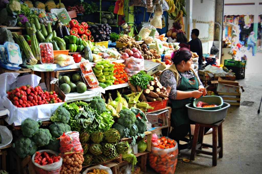Exploring a local market on a food tour through Lima, Peru