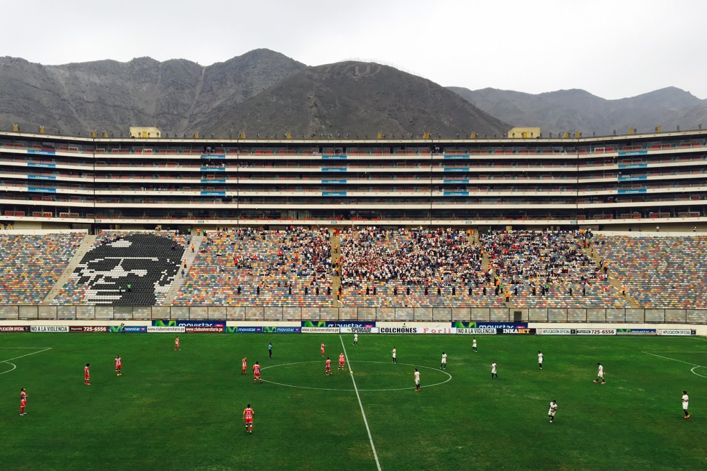 Watching a soccer match at Estadio Monumental in Lima, Peru
