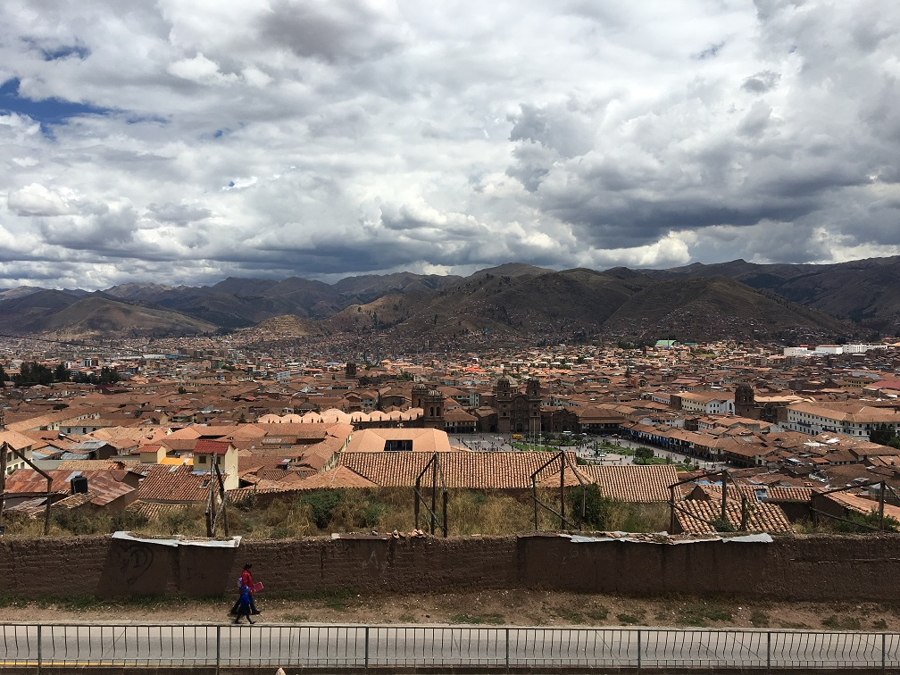 Mother walking her child home after school in Cusco, Peru