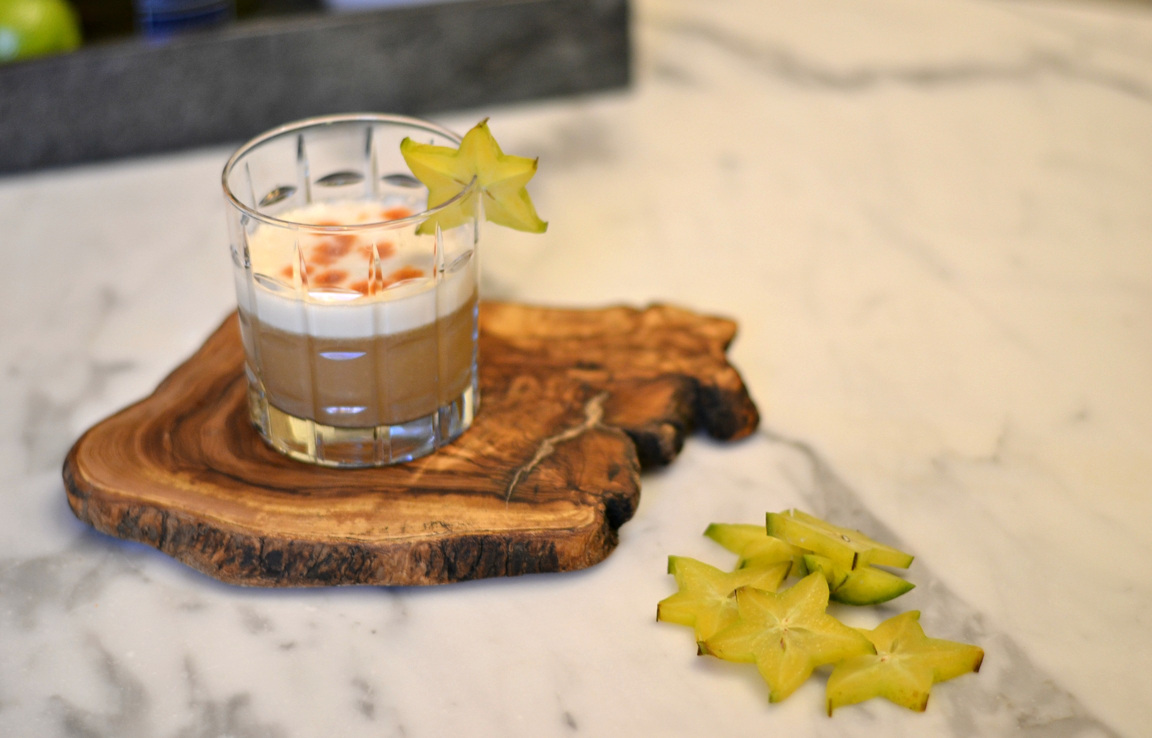 Pisco sour cocktail garnished with a slice of starfruit