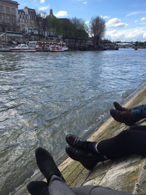 Sitting with friends along the River Seine