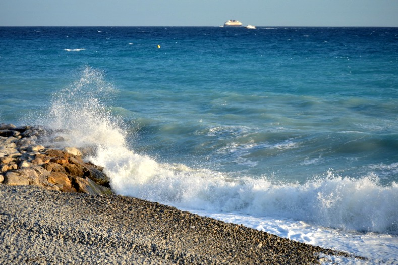 Waves crashing along the shore in Nice, France