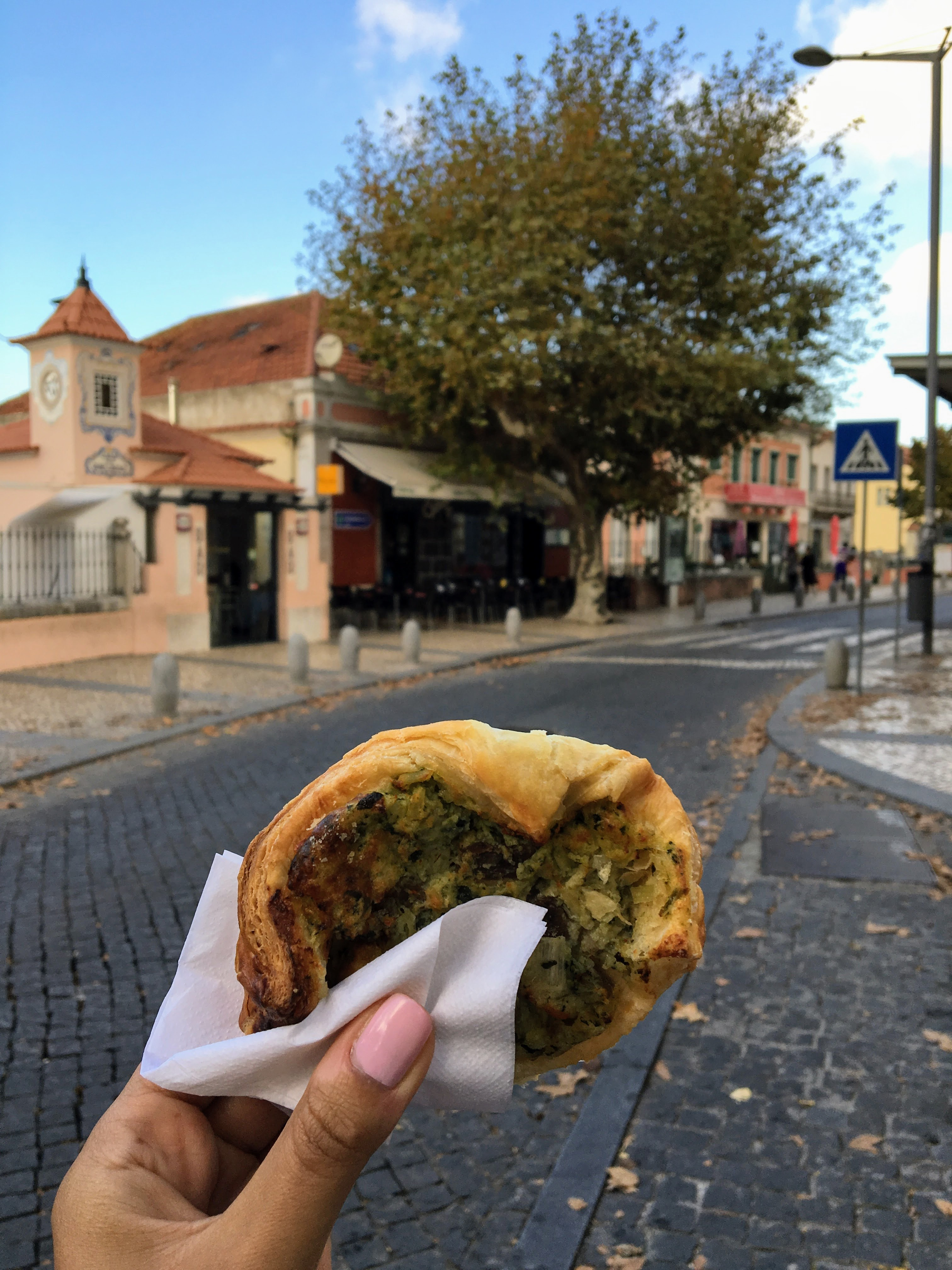 Eating a savory danish in Sintra, Portugal