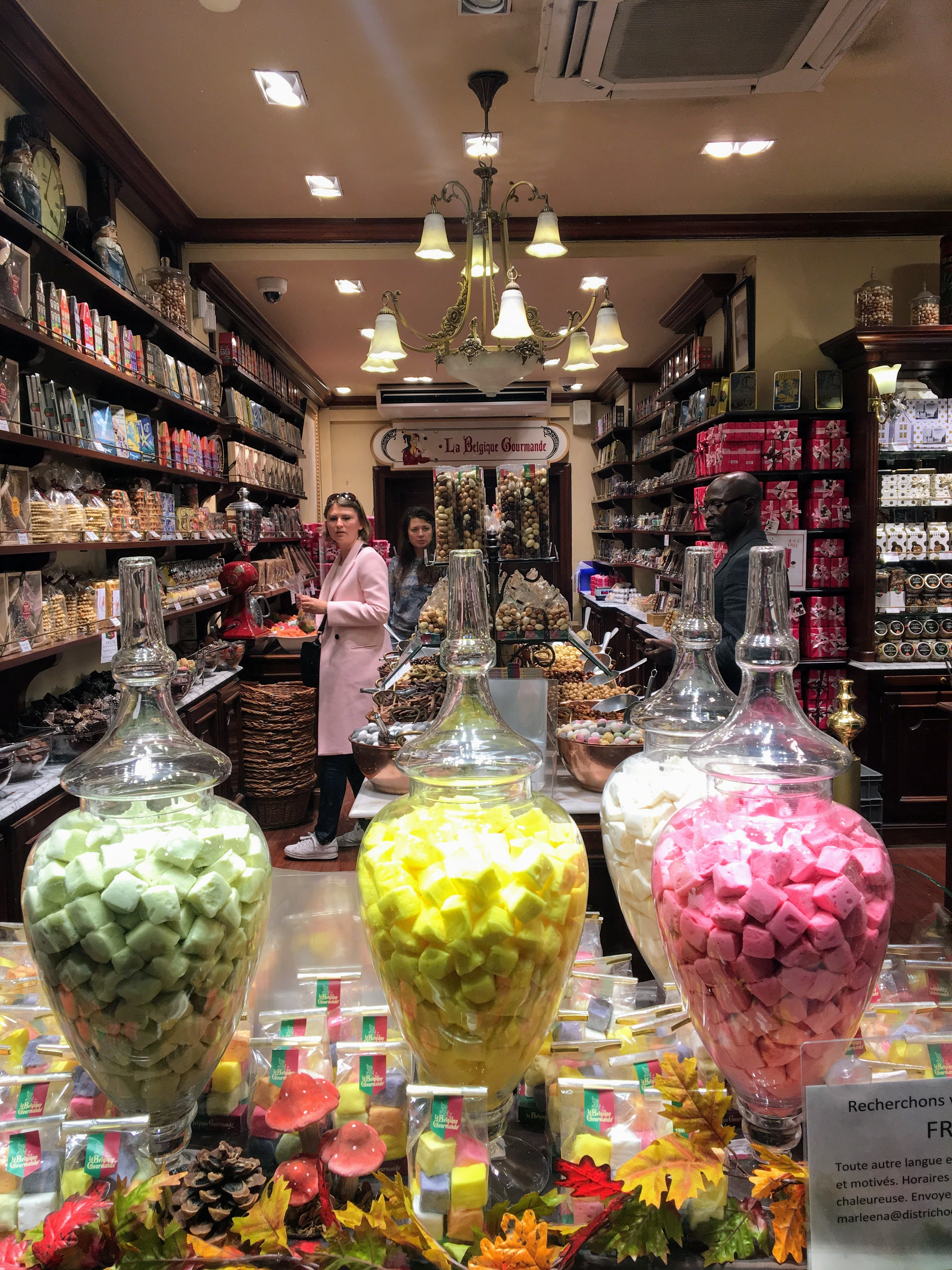Candies and Belgian chocolate in a storefront window in Brussels, Belgium